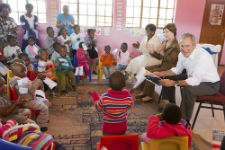 President Bush and Laura Bush read to students at the Gabane Community Home-Based Care Center (Courtesy of the Bush Center).