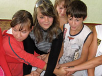 Ukrainian students attending Camp I Believe try their luck at a human knot.
