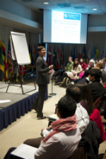 RPCVs listen a speaker