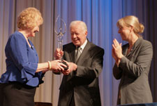 Former President Jimmy Carter, Peace Corps Deputy Director Carrie Hessler-Radelet, and returned Peace Corps volunteer Diane Gallagher.