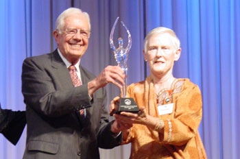 Lillian Carter Award winner Dr. Catherine Taylor Foster with former President Jimmy Carter