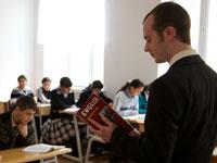 Peace Corps/Azerbaijan volunteer Evan Cook, a secondary school TEFL teacher from Staunton, Va., teaches English classes at the local school.