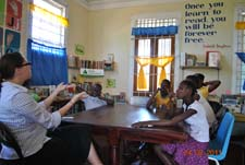 Peace Corps volunteer Megan Hicks teaches sign language to deaf students in Jamaica.
