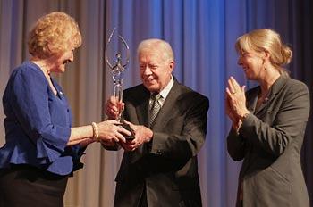 Lillian Carter Award winner Diane Gallagher with former President Jimmy Carter and Peace Corps Deputy Director Carrie Hessler-Radelet
