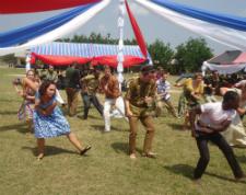 Volunteers in Ghana perform a traditional dance