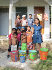 Peace Corps volunteer Ashley Gleasons environmental youth group after painting buckets for recycling.