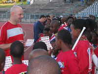 Students get autographs from soccer player and U.S. men's national team goalkeeper Marcus Hahnemann.