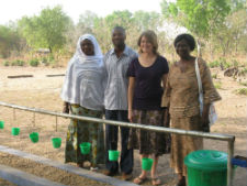 Peace Corps volunteer Megan Farmer with local community leaders in front of a handwashing station in Togo.