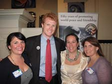 Vice President of the Boston Area Returned Peace Corps Volunteers (BARPCV ) Jacquelyn Caglia, Joe Kennedy III, Peace Corps New England Regional Manager Erin Mone-Marquez, and BARPCV President Christine Claypool at the May 6 ceremony in Cambridge, Mass.