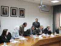 Peace Corps Director Aaron S. Williams and Jordan Minister of Education Ibrahim Badran sign a partnership agreement.