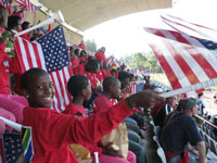 Students wave American flags and cheer on the U.S. men's national team.