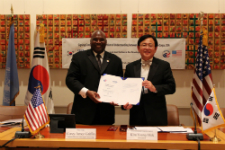 Representatives from Peace Corps and KOICA sign the MOU