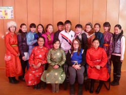 Peace Corps volunteer Brittany Neace and one of her youth groups celebrate White Month, a traditional Mongolian holiday.