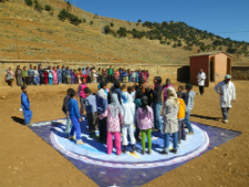 Kids in Morocco play a game to learn about climate change