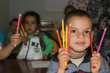 Moroccan student with his new colored pencils