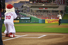Peace Corps Director Aaron S. Williams throws the first pitch at Peace Corps night with the Washington Nationals.
