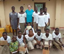 Peace Corps volunteer Emily Jones with one of the community girls groups, who will have access to the library.