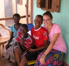 Peace Corps volunteer Emily Jones with Togolese youth in her community.