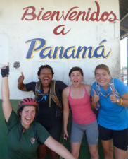 Peace Corps/Costa Rica volunteers Julia Lockamy, Kristen Lucas, Nicole Budzious and Marissa Strniste pose at the Panamanian border after completing the 233 mile bike ride.