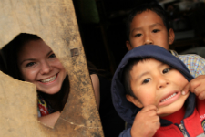 Peace Corps volunteer Alison Foley with youth in her community.
