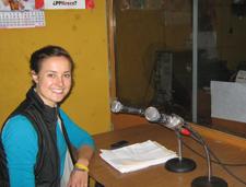 Peace Corps volunteer speaks on the radio in Peru.