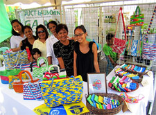 Women in the Bag-O Plastic group sell their products.