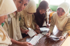 Students read a postcard together
