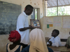 A teacher uses the new skills to read to his students