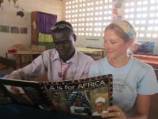 Szuwalski reads with one of the teachers