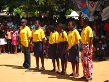 Girls in a REDES group perform a skit during the town's celebration for Mozambican Women's Day on April 7th. They wrote the skit, which was about a 16-year-old girl whose parents want her to drop out of school to get married because it will give them financial stability, but her friends counsel her and her parents to allow her to stay in school. She ends up becoming a successful doctor and her parents thank her friends for their advice.