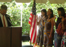 U.S. Ambassador Koran swearing in the new Peace Corps volunteers in Rwanda.