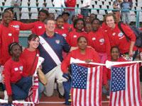 U.S. U.S. Ambassador Donald Gips poses for a photo with students.