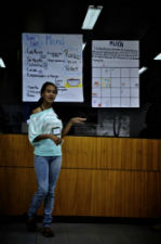 A workshop participant presents a business plan she created based off of information from the sessions, guest speakers and case studies.