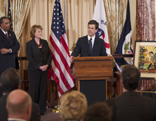Special Olympics Chairman and CEO Tim Shriver speaks about the Peace Corps and his father, Sargent Shriver, the first Peace Corps director. Peace Corps Director Aaron S. Williams and Under Secretary of Public Diplomacy and Public Affairs Judith McHale stand left.
