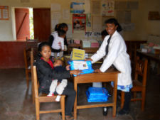 Peace Corps volunteer Teena Curry teaches people in Madagascar ways to prevent malaria.