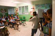 Peace Corps volunteers in the Dominican Republic shoot a scene in the telenovela.