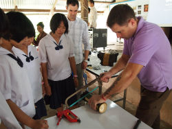Peace Corps volunteer Roger Brubaker demonstrates how to make an ovitrap.