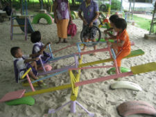 Children play on a playground made from recycled materials.