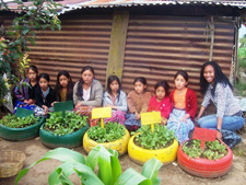 Howard University graduate and Peace Corps/Guatemala volunteer Keisha Herbert with girls she taught to create vegetable gardens in recycled car and truck tires.