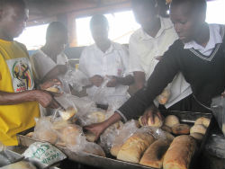 Students package the bread they made to sell in their local community.