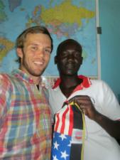 Peace Corps volunteer Matthew Boddie with his Ugandan counterpart.