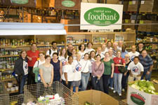 Peace Corps Deputy Director Carrie Hessler-Radelet and Peace Corps staff at the Capitol Area Food Bank in Washington, D.C.