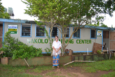 Peace Corps volunteer Sarah Weiner in front of the learning center in Tonga.