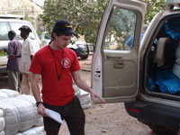 Kris White, a Peace Corps Response Volunteer in Senegal, helps distribute mosquito nets.