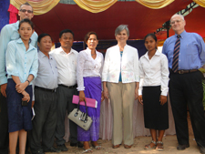 Peace Corps volunteer Ryan Young (left) with students, school teachers and administrators, U.S Ambassador to Cambodia Carol A. Rodley (center), and Peace Corps Country Director for Cambodia, Jon Darrah, (far right) at the resource centers opening celebration.