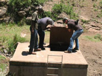 Peace Corps volunteer Phil Youngren (right) working with local community members on a new water infrastructure project in Lesotho.