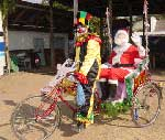 Photo of Santa riding in a rickshaw