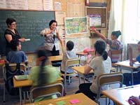 Lorien teaches an English class using interactive games highly enjoyed by the students participating.