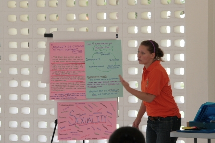 Ashley Benson gives a talk to community members in Guyana about prevention and healthy lifestyles for youth and adolescents.