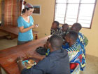 Sarah Ellison, a Peace Corps Response Volunteer in Benin, teaches art to children and local artists at the International Center for Art and Music in Ouidah.